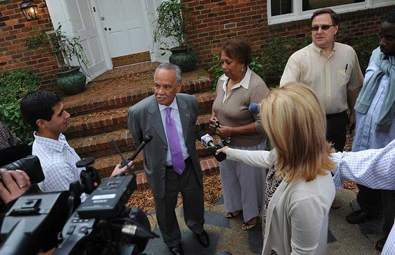 Ray Boone and his wife, Jean, give a news conference welcoming Occupy Richmond protesters to their front yard Nov. 15. The city recently cited the encampment as a zoning violation, but Boone plans to fight the citation. - SCOTT ELMQUIST