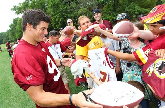 Redskins linebacker Ryan Kerrigan signs autographs during Fan Appreciation Day at last summer's training camp in Ashburn. Such fan days can draw upward of 30,000 people. - WASHINGTON REDSKINS