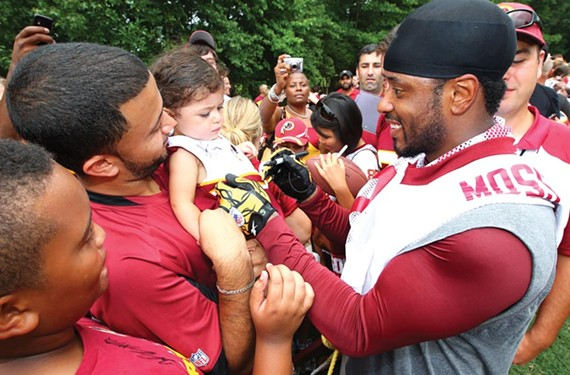 Redskins' receiver Santana Moss signs autographs during the 2010 training camp, which Loudoun County officials say generated about $1 million in economic impact. - WASHINGTON REDSKINS