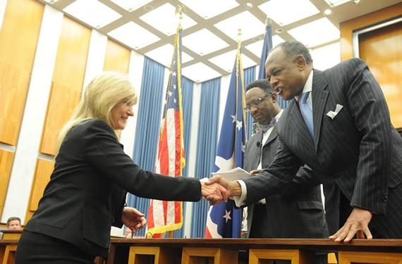 Reva Trammell shakes Mayor Dwight Jones' hand after being sworn in last January. - SCOTT ELMQUIST