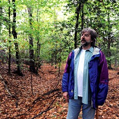 Richmond Battlefields Association member Ben Brockenbrough stands at Fussell's Mill, where remnants of Confederate trenches lie under the leaves.