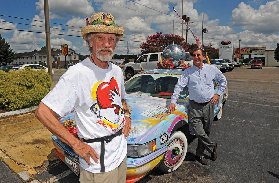 """Richmond muralist J.P. """"Happy the Artist"""" Kuhn, left, sold his Hugmobile to Bill Simmons, general manager of Haley Certified Toyota. - SCOTT ELMQUIST"""