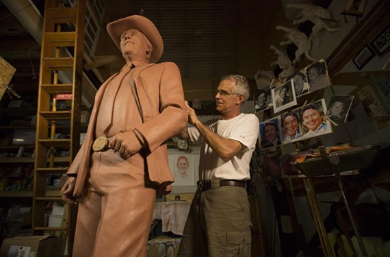 Richmond sculptor Paul DiPasquale works on the full-scale, clay model of his soon-to-be completed statue of the late entertainer Jimmy Dean. - CHEYENNE MCQUILKIN