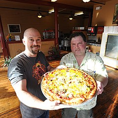 Richmond's seemingly insatiable appetite for pizza gets a new option — the Paul Bunyan, shown off by Victor Wine and Bob Buffington at their new Church Hill cafe.
