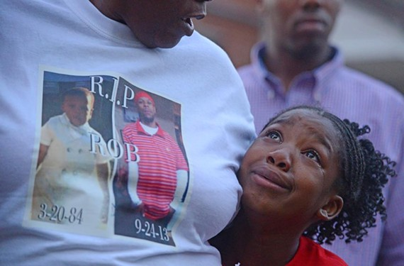 Richmond's 24th homicide victim of 2013 was Robert L. Poag. The 29-year-old was shot to death Sept. 24 in the 2100 block of Deforrest Street in the Whitcomb Court public housing community. Poag's cousin, Adrianna Avery, is comforted by Robert's mother, Felicia Dixon, at a vigil on Oct. 3.
