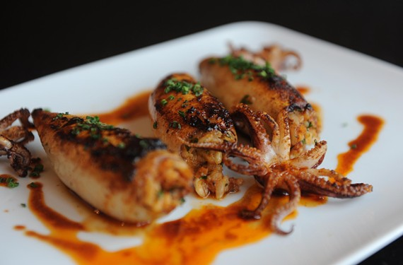 Roast squid with chorizo and rice from Aziza's on Main, our 2013 Restaurant of the Year. - SCOTT ELMQUIST