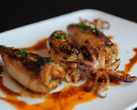 Roast squid with chorizo and rice from Aziza's on Main, our 2013 Restaurant of the Year.