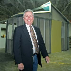 Robert Rogers stands next to a prototype of the house he plans to manufacture and send to disaster-ravaged countries. - PHOTO BY SCOTT ELMQUIST