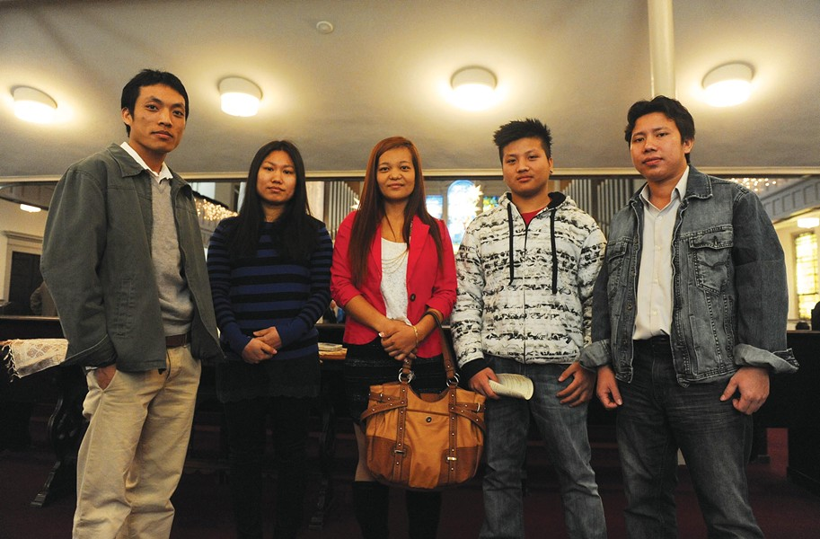Sai Lat, Siang Siang, N. Sui Vang, Ta Mawi and Khai Bil pose for a photo after being formally accepted as members of Tabernacle Baptist Church during a recent service. - SCOTT ELMQUIST