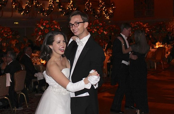 Sarah Matheson takes the floor with Cole Rumbough, a jazz singer, at the International Debutante Ball at New York's Waldorf Astoria.
