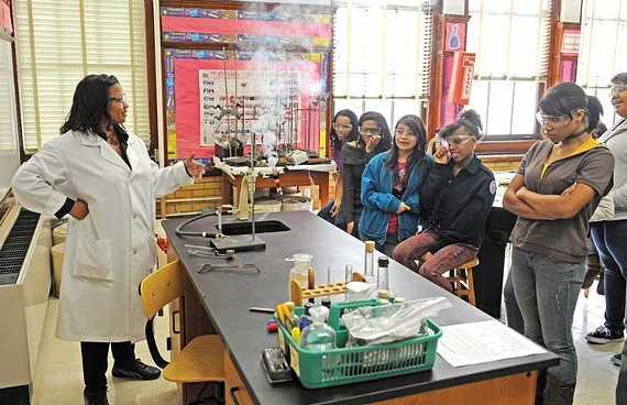 Science instructor Danica Millner, in the lab at Thomas Jefferson High School, says the Richmond Public Schools will need to hire more science teachers to enhance their advanced-placement program. - SCOTT ELMQUIST
