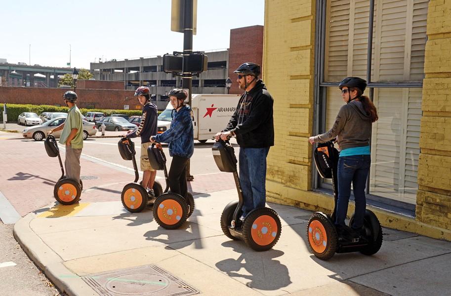 Segway riders cross 14th Street downtown. - SCOTT ELMQUIST