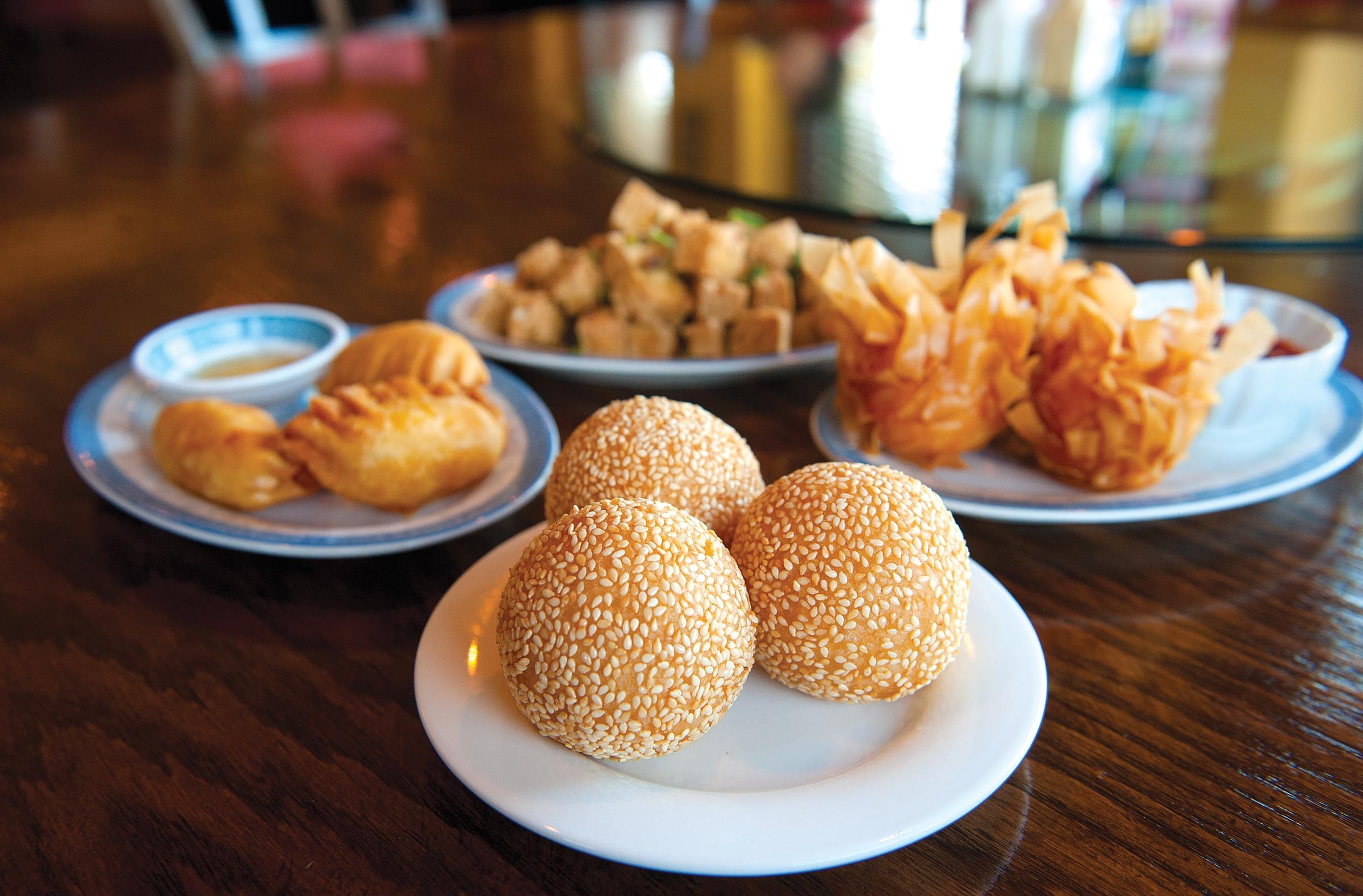 Sesame balls, shrimp balls, fried shrimp and cheese dumplings and salt and pepper diced tofu bring pleasure from the cart at Queen's Dim Sum on West Broad Street. - SCOTT ELMQUIST