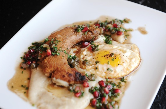 Shad roe is accented with a sunny-side-up egg, sun-choke purée, pomegranate and capers. - SCOTT ELMQUIST