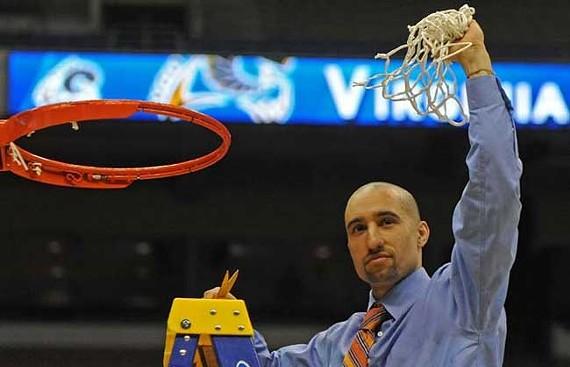 Shaka cuts down the net after beating Kansas in San Antonio. - SCOTT ELMQUIST