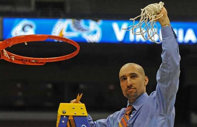 Shaka cuts down the net after beating Kansas in San Antonio. - SCOTT ELMQUIST
