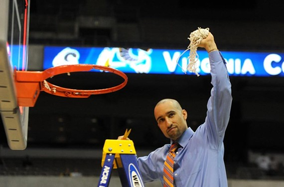 Shaka Smart helps cut down the nets in 2011, when the VCU Rams became the Southwest Regional champions in San Antonio. Now he's in the Lone Star State for a different reason — coaching the University of Texas men's basketball team.