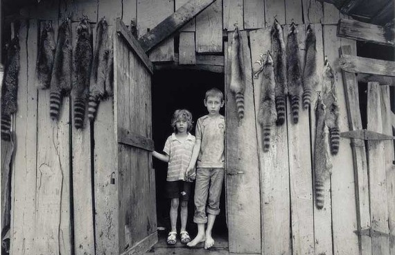 "Shelby Lee Adams' ""Billy and Bethany with Coonskins"" (2004) is one of the arresting images on display in a new book and accompanying gallery exhibit. ""Salt and Truth"" charts photographer Adams' 35-year journey in documenting the hard lives of eastern Kentucky residents."