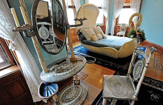 Silver streak: A Tiffany and Co. dressing table and chair, in the viking revival style, adorn the second floor of the Maymont Mansion. - SCOTT ELMQUIST