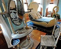 Silver streak: A Tiffany and Co. dressing table and chair, in the viking revival style, adorn the second floor of the Maymont Mansion.