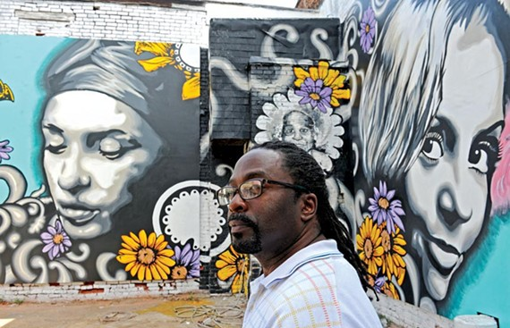 Sir James Thornhill and three other artists worked on the mural at Adams and Broad streets, which pays homage to Jackson Ward theater. - SCOTT ELMQUIST