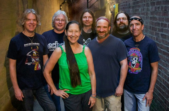 Smell the patchouli from here? Dark Star Orchestra drummer Rob Koritz stands to the right of vocalist Lisa Mackey, who sings the parts of former Grateful Dead backup vocalist Donna Jean Godchaux.  The band has been called one of the best tribute acts in the country.