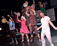 """Snoopy (Matt Shofner, at front right) leads the cast of """"You're a Good Man, Charlie Brown"""" in a rousing ode to his supper dish."""