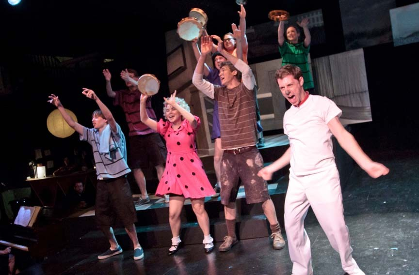 "Snoopy (Matt Shofner, at front right) leads the cast of ""You're a Good Man, Charlie Brown"" in a rousing ode to his supper dish."