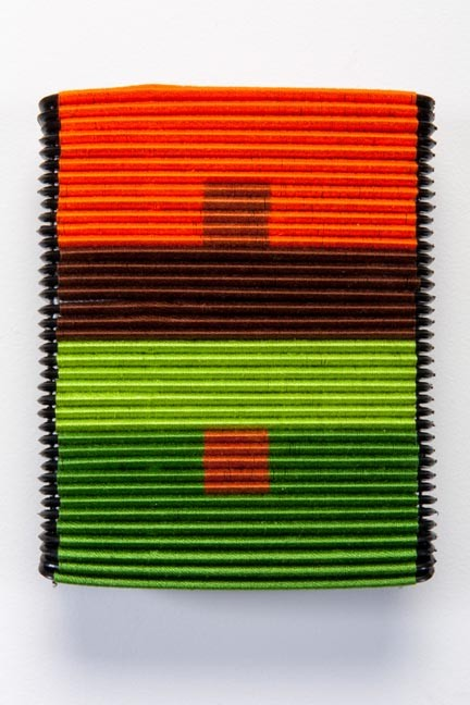 "Sonya Clark's thread-wrapped ""Albers Comb."""