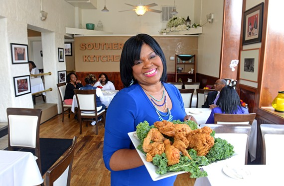 Southern Kitchen owner Shane Thomas makes guests welcome with a platter of her excellent fried chicken.