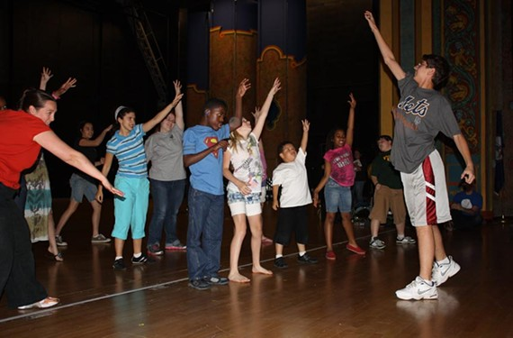 "SPARC staffer Melody Winters, at left, leads students through a rousing musical number slated for ""Live Art"" at CenterStage on June 3. The kids include Liberty Arbitelle, Natalie Schwartz, Juliet Fugman, J'kwan Pryor, Sam Hanczaryk, Jamel Lanier, Shanti Bhagat, Bryson Olivo and Chris Russo."