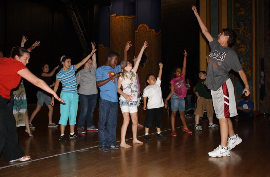 """SPARC staffer Melody Winters, at left, leads students through a rousing musical number slated for """"Live Art"""" at CenterStage on June 3. The kids include Liberty Arbitelle, Natalie Schwartz, Juliet Fugman, J'kwan Pryor, Sam Hanczaryk, Jamel Lanier, Shanti Bhagat, Bryson Olivo and Chris Russo."""