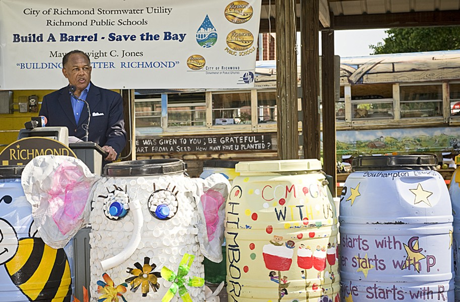 """Standing behind a row of painted rain barrels at Saturday's opening of the 17th Street Farmers' Market, Mayor Dwight C. Jones unveils """"the next major step"""" in making Richmond a greener city. - ASH DANIEL"""