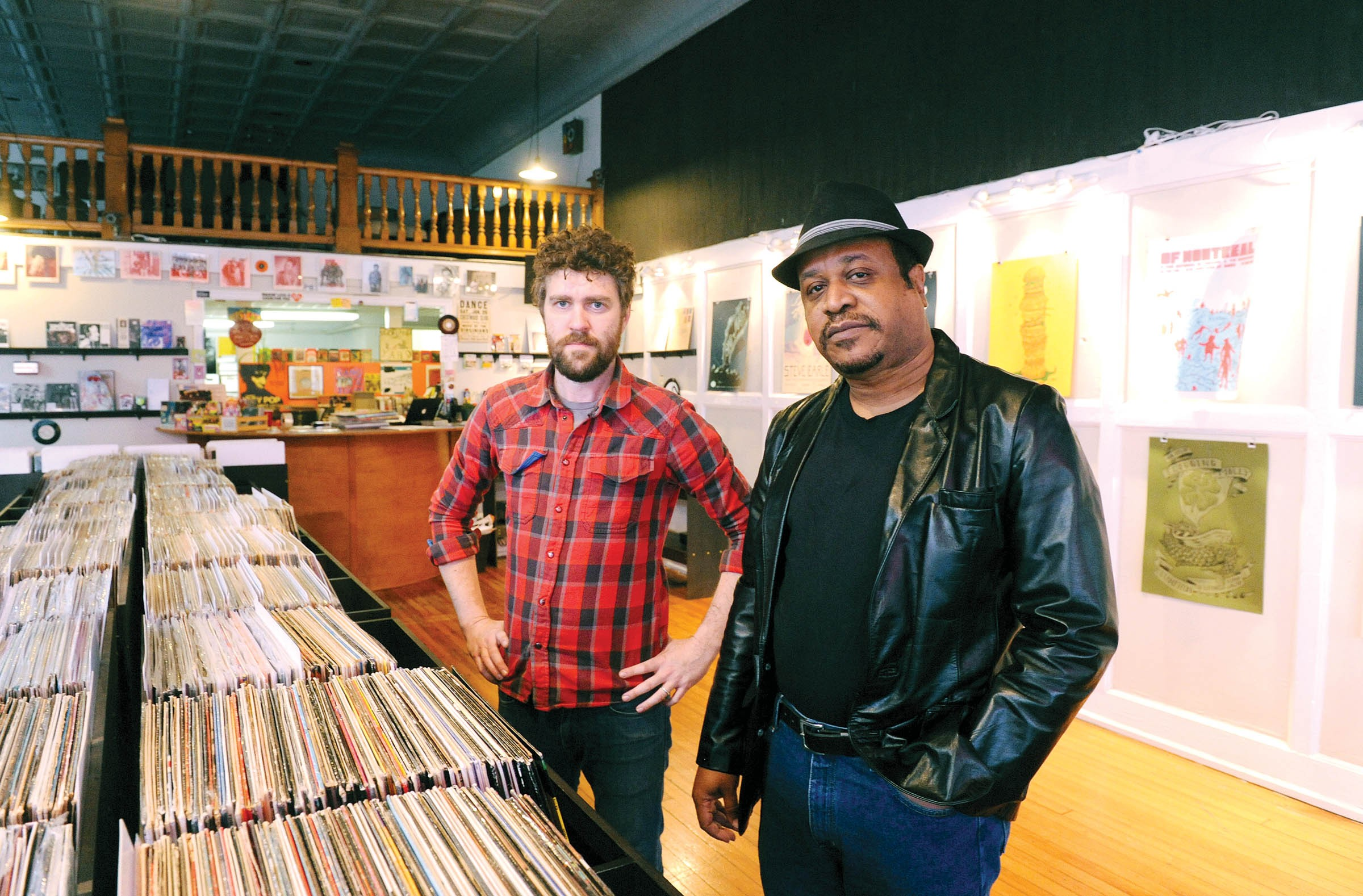 """Steady Sounds co-owner Marty Key, at left, couldn't believe his ear holes when he heard the bedroom funk demos saved up for the last 30 years by local musician Max Monroe. Together, Steady Sounds and the Washington-based People's Potential Unlimited have released """"The Trash Company: the Earle Hotel Tapes: 1979 – 1993"""" (inset). The cover was designed by local art director Doug Dobey. - SCOTT ELMQUIST"""