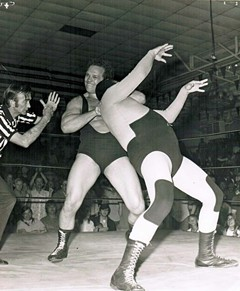 Steinborn puts a sleeper hold on the Assassin I, one-half of the team known as the Assassins, during a match in Atlanta.