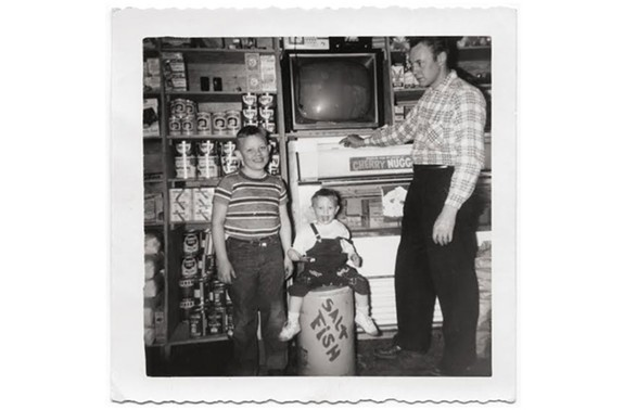 Steve, his brother, Buster, and father Carlton Layne in the original Lexington store. The store stocked everything from grocery items to mattresses. - PHOTO COURTESY OF MARGARET BUCHANAN