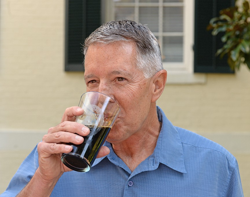Stone president and co-founder Steve Wagner sips a glass of Stone's Smoked Porter while he talks to reporters. - SCOTT ELMQUIST