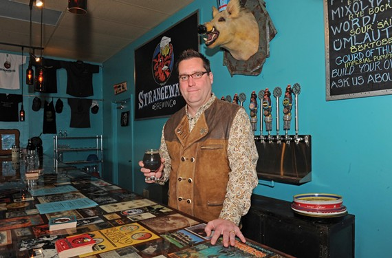 Strangeways Brewing founder Neil Burton with its Gourd of Thunder Imperial Pumpkin Porter. - SCOTT ELMQUIST