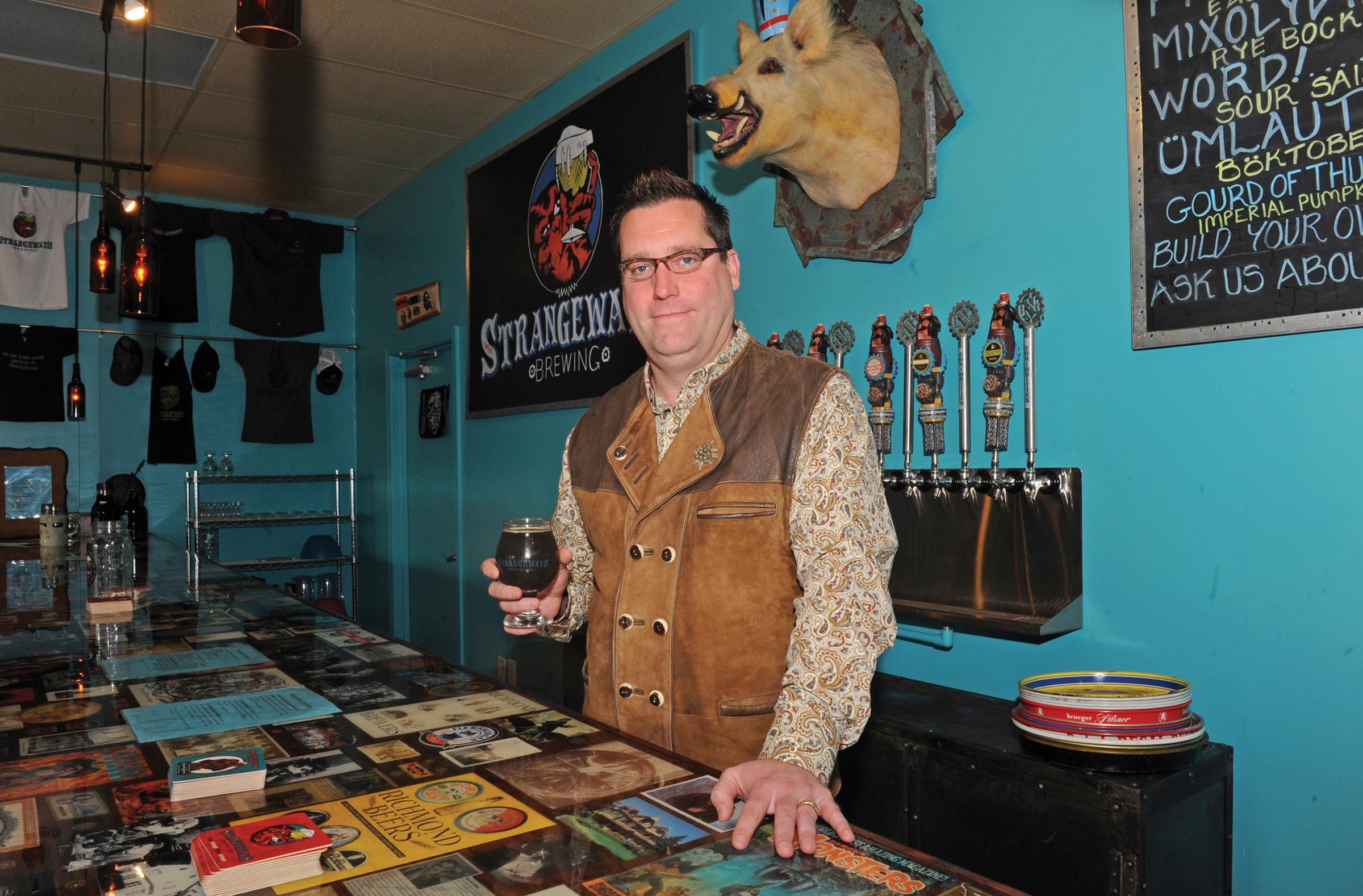 Strangeways Brewing founder Neil Burton with its Gourd of Thunder Imperial Pumpkin Porter. - SCOTT ELMQUIST