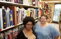 Student assistant Celina Williams and Cindy Jackson stand in front of one of the many shelves at VCU's comic repository. Since starting at the library, curator Jackson has seen the collection grow to more than 150,000 items.