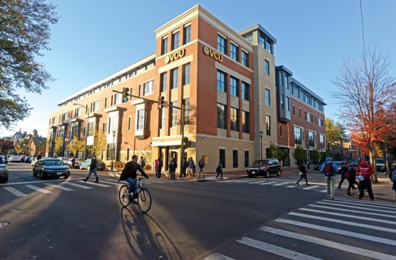 Students scurry across the intersection of Floyd Avenue and Linden Street, where VCU recently opened a handsome new classroom building.