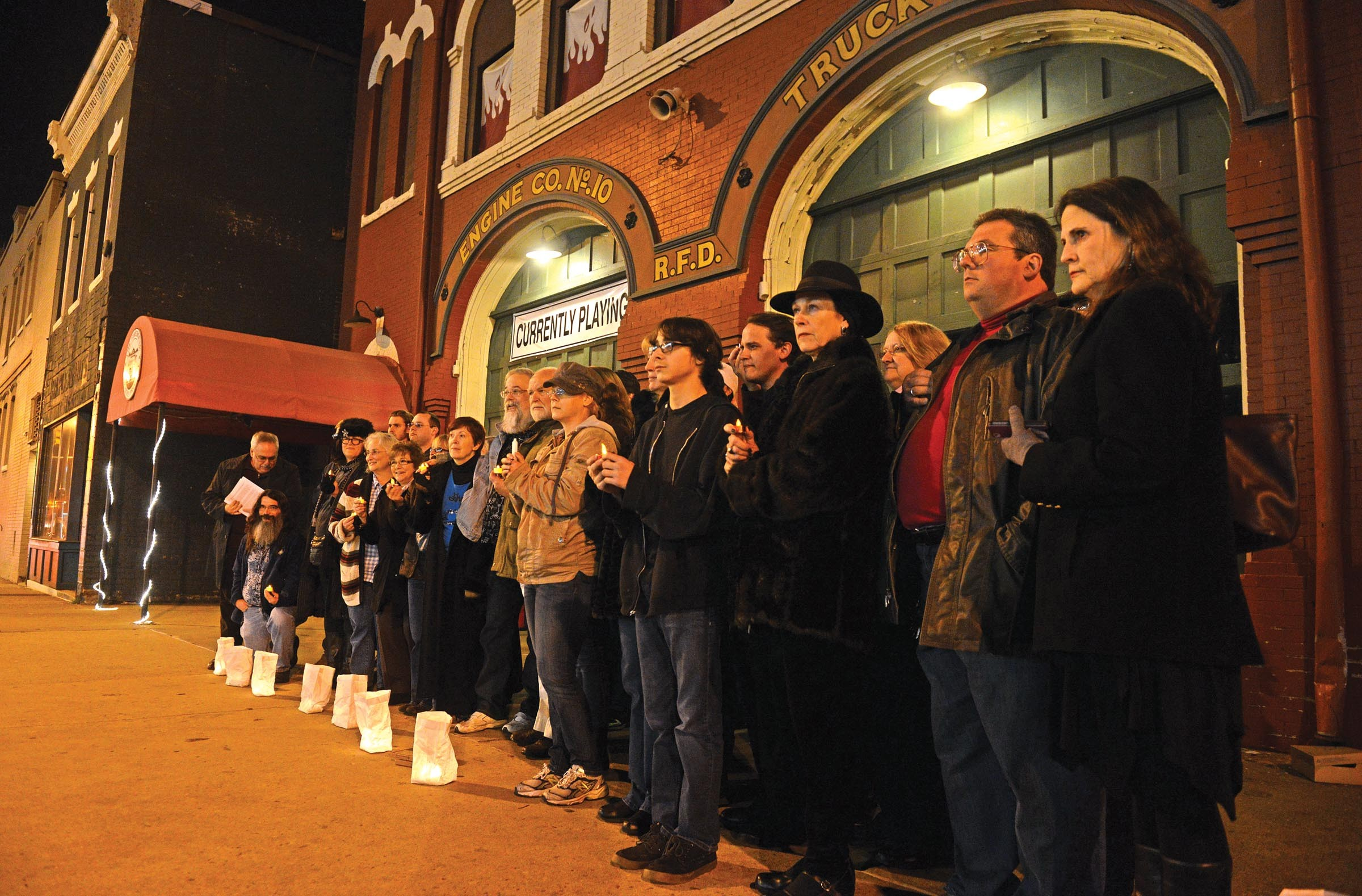 """Supporters of Carol Piersol line the Firehouse Theatre in a silent protest last week during the opening of """"Zhe: [noun] Undefined."""" The traveling show wasn't produced by Firehouse. - SCOTT ELMQUIST"""