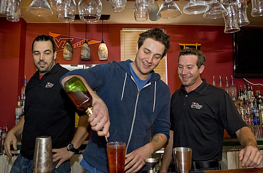 Tending to the basics: Skeptical columnist Jack Lauterback, center, weighs the pros and cons of bartending school with trainer Bradley Gallier, left, and Mike Love, director of Richmond's Professional Bartending Academy. - ASH DANIEL