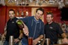 Tending to the basics: Skeptical columnist Jack Lauterback, center, weighs the pros and cons of bartending school with trainer Bradley Gallier, left, and Mike Love, director of Richmond's Professional Bartending Academy.