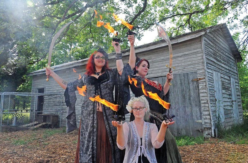 The Ashland Arts Alliance recently held a Beltane festival in Doswell that featured Clockwork Collective fire dancers Nicole Randall (front), Heather Addley and Courtney Ford. The festival is only one of many events co-sponsored by the newly-formed alliance, which is dedicated to creative self-expression. - SCOTT ELMQUIST