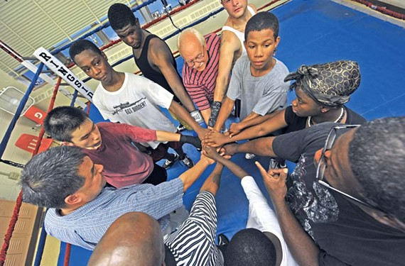 "The boxers join hands for a prayer, which usually is accompanied by a lesson from their coach. ""If you don't have any stumbling blocks,"" Royster says, ""you don't have any trials, any troubles — then you can't appreciate the good times."" - SCOTT ELMQUIST"