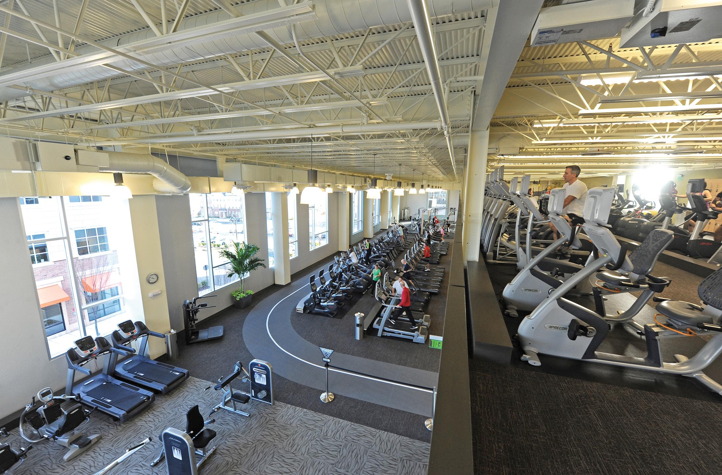 The cardio level of the ACAC fitness and wellness center comes to life on a recent afternoon. - SCOTT ELMQUIST