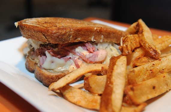 The classic Reuben with fries shows the comfort-food direction of the Well, now serving nightly except Sunday in the former Cous Cous space. Food specials, live music and late night kitchen hours are part of the mix. - SCOTT ELMQUIST