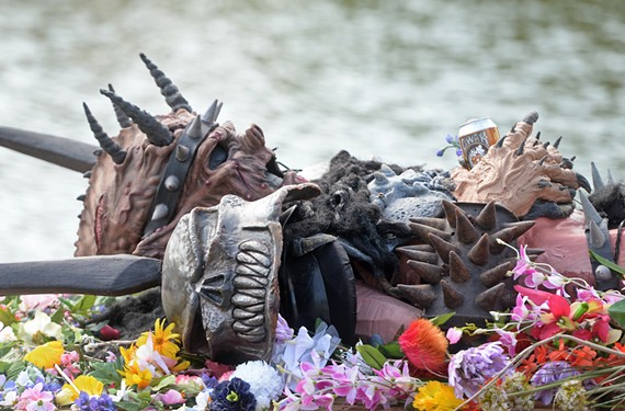 The empty costume of Oderus Urungus, played by the late Dave Brockie, awaits his Viking-style sendoff at Hadad's Lake on Aug. 15, 2014. (File Photo)