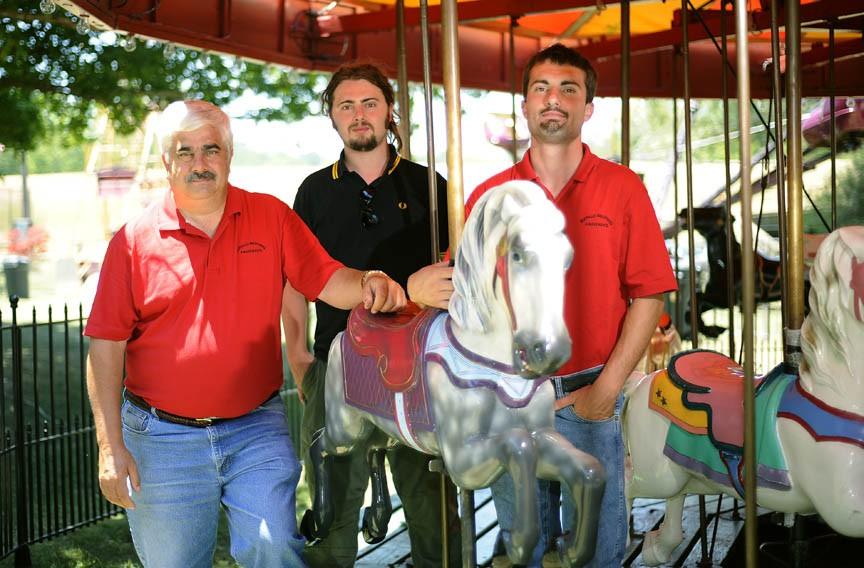The Harris Family of Staunton — father Will and brothers Lee and Tommy — restore antique carnival rides like this 1915 Spillman Engineering wooden carousel, the oldest touring carousel in the country. - PAT JARRETT/VIRGINIA FOLKLIFE PROGRAM